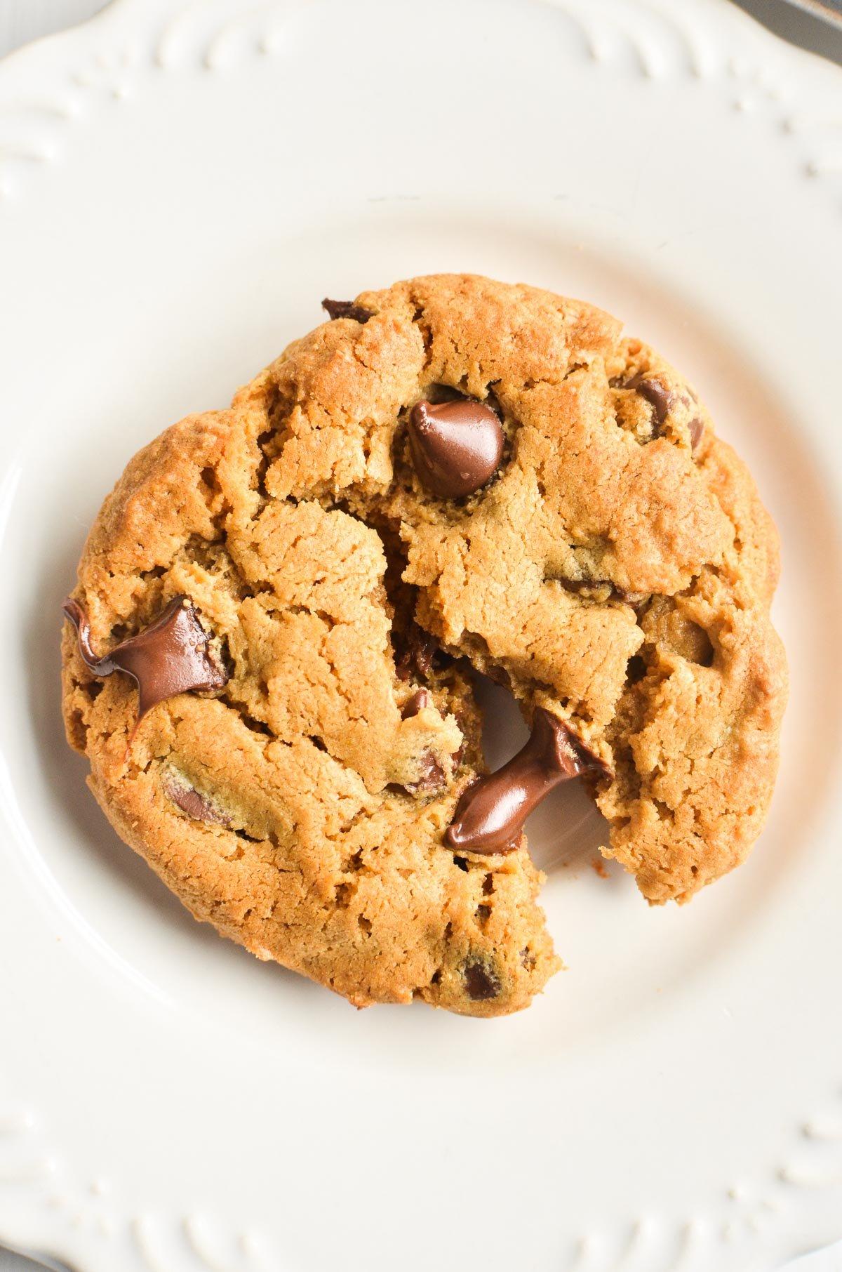 A partially broken open flourless peanut butter cookie.