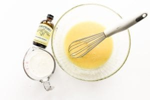 whisking together lemon muffin batter with buttermilk and lemon extract