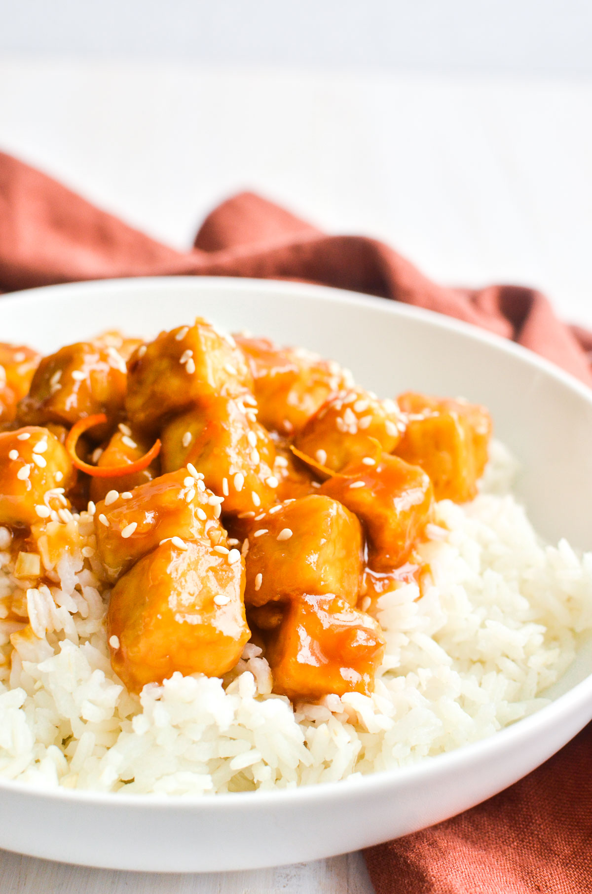 Orange tofu with rice and sesame seeds