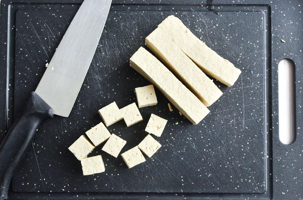 slicing tofu on a cutting board