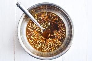 Sauce for orange tofu, in a metal bowl