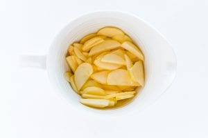 A close up of sliced apples in a bowl