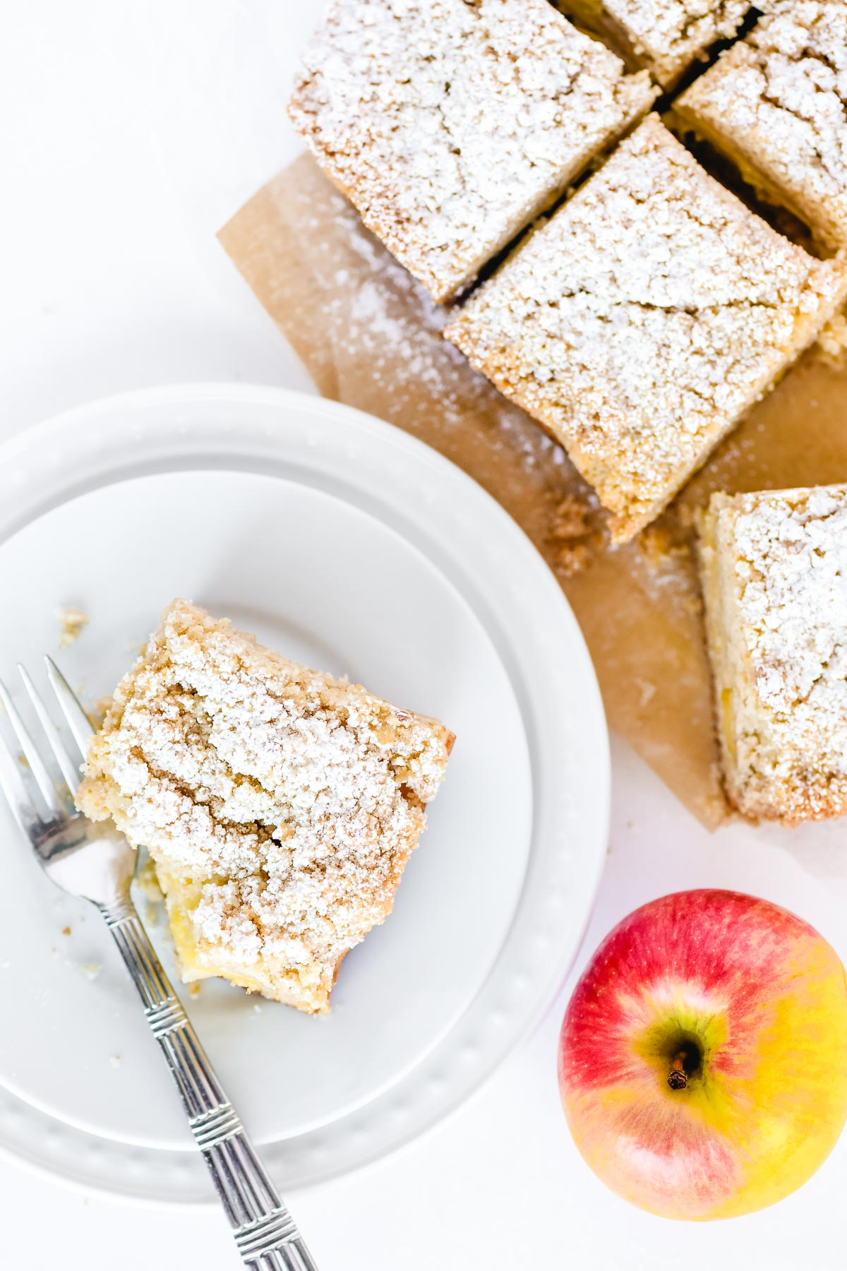 apple crumb bars on a plate with an apple