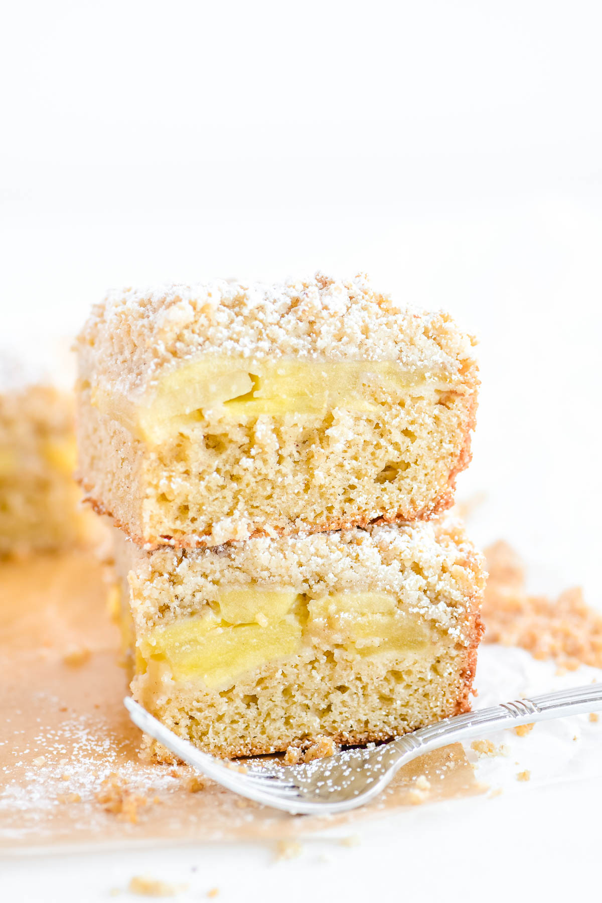 stacked apple crumb bars with fork