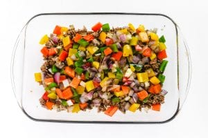 colorful onions and peppers in a casserole dish
