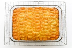 Breakfast casserole topped with Tater Tots, baked