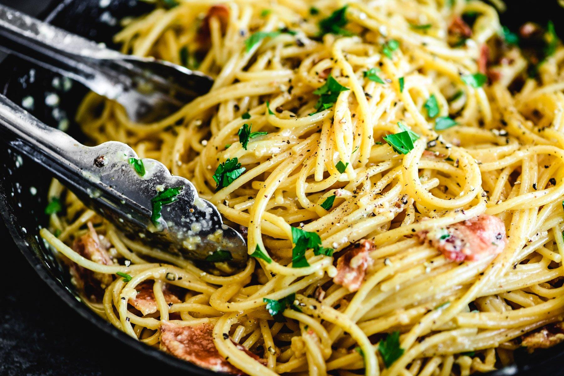 breakfast pasta carbonara in a cast iron skillet