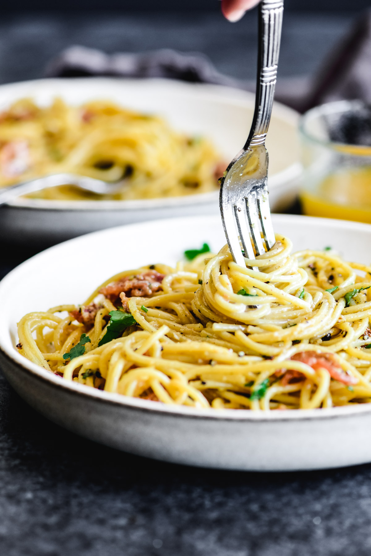 twirling pasta carbonara onto a fork