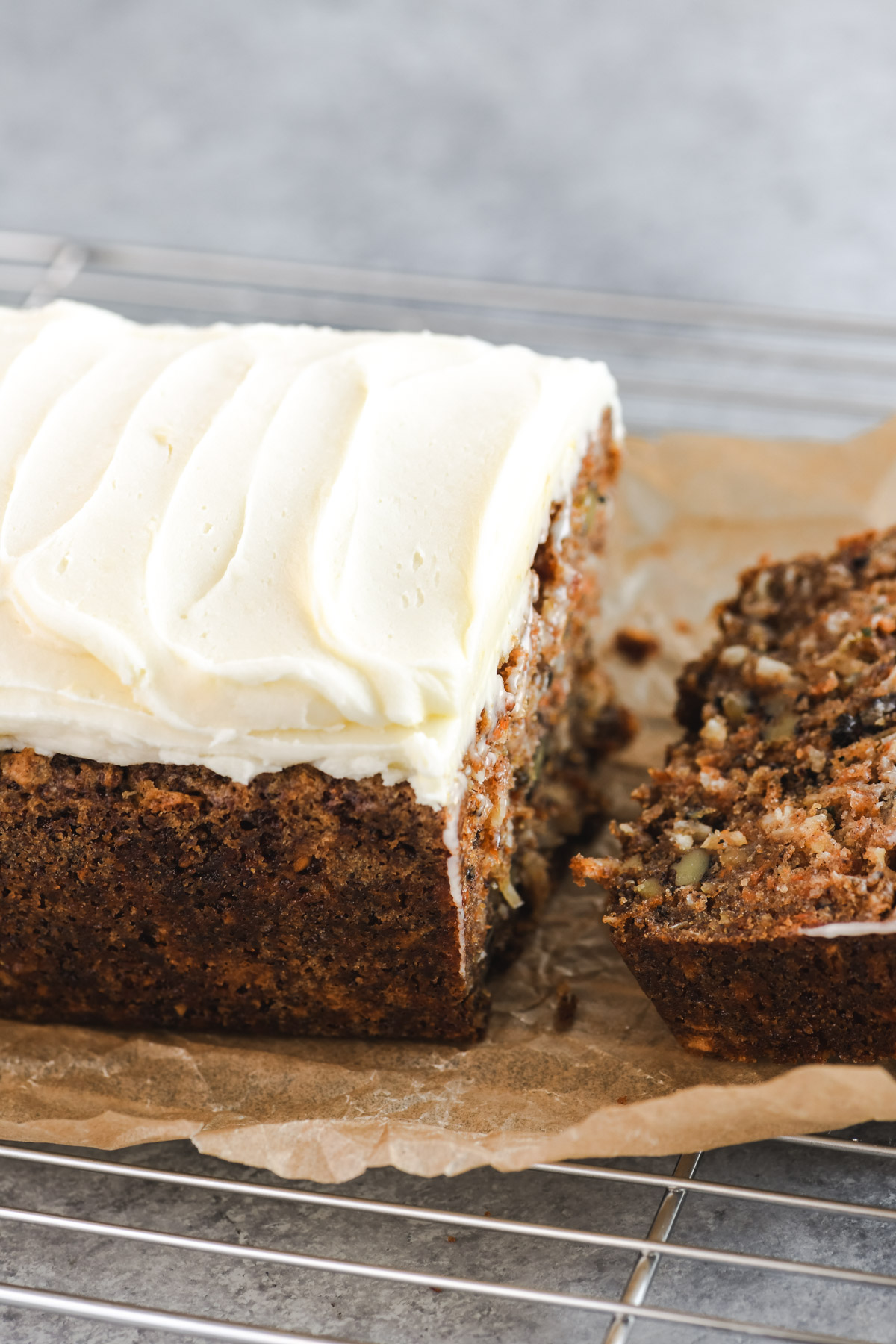 carrot cake bread topped with cream cheese frosting, sliced