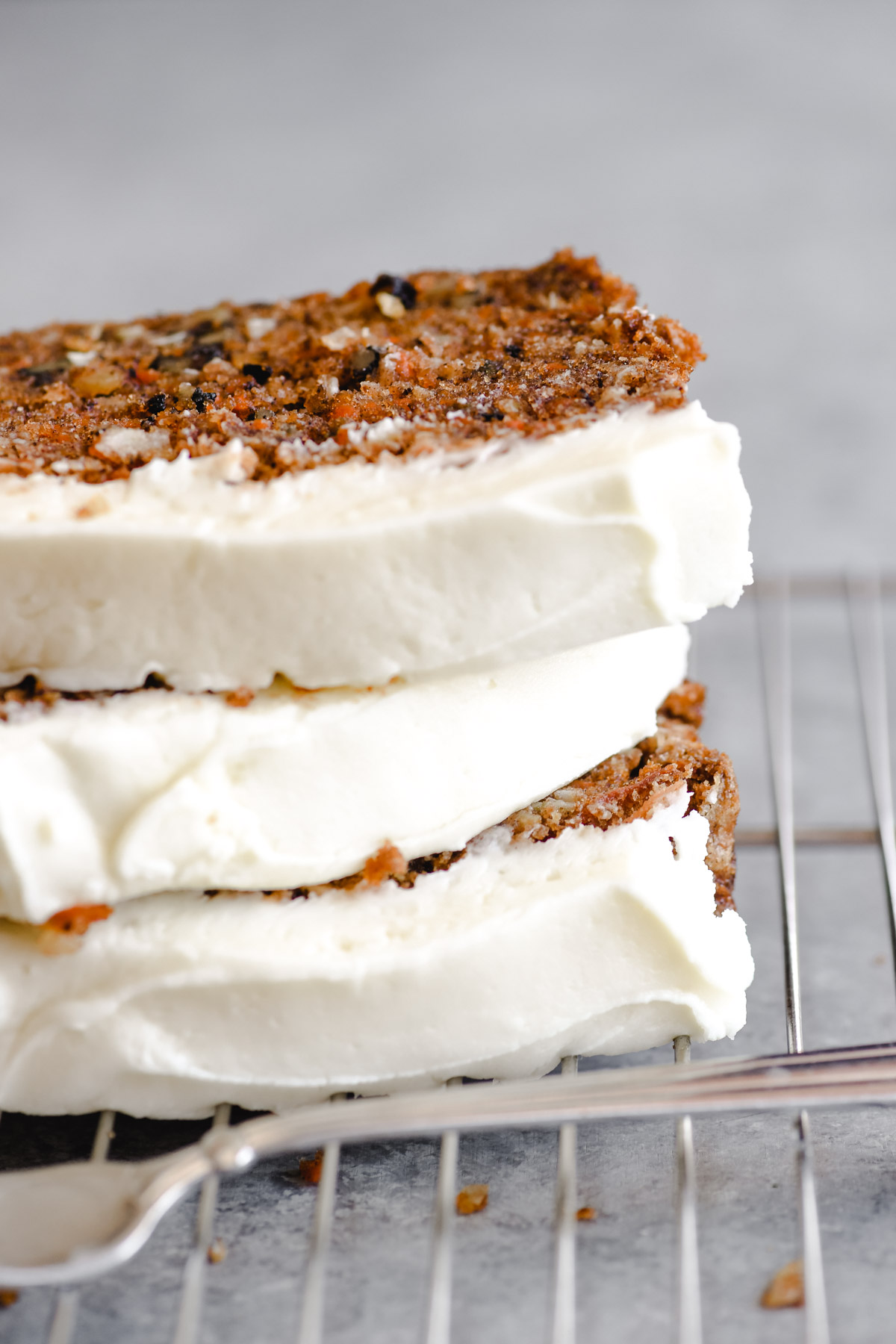 A stack of cream cheese frosted carrot cake bread slices