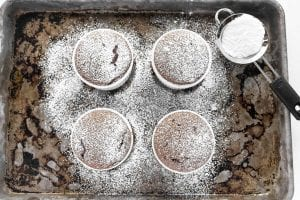 Individual chocolate souffles, topped with powdered sugar