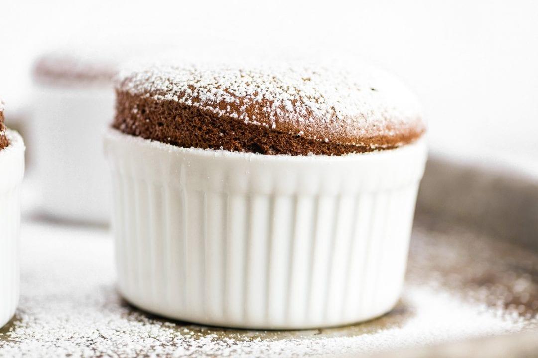 chocolate soufflé in a white ramekin