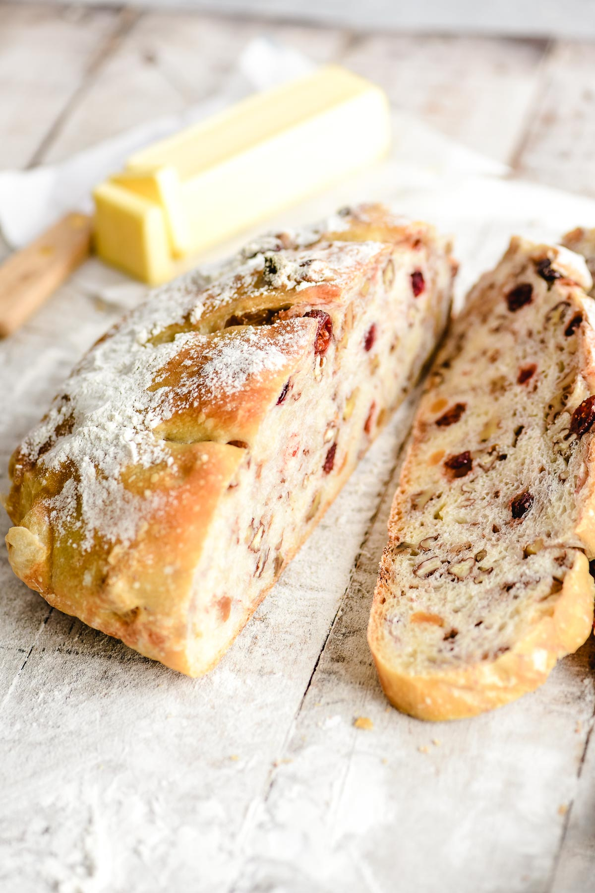 fruit and nut bread, sliced, with butter