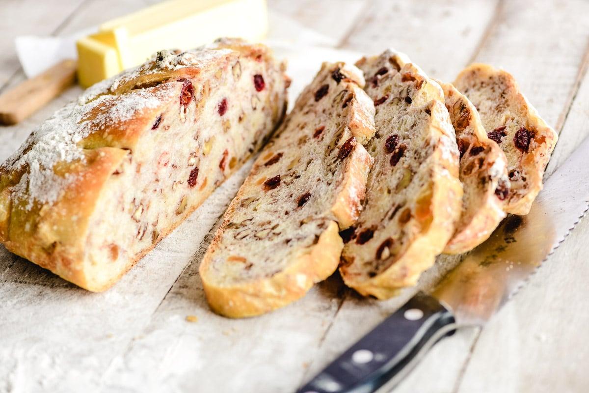 no knead trail mix bread, sliced on a floured board