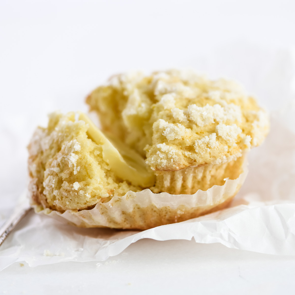 lemon muffin with pat of butter