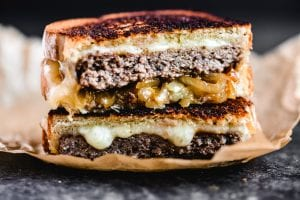 a grilled patty melt with gooey cheese