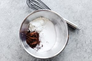 whisking dry ingredients for chocolate pudding