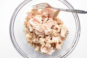 canned tuna in a glass bowl with fork