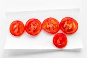 Draining tomato slices for tuna melts