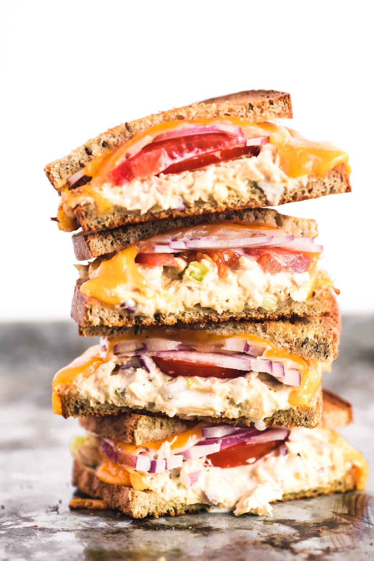 a tall stack of tuna melt sandwiches