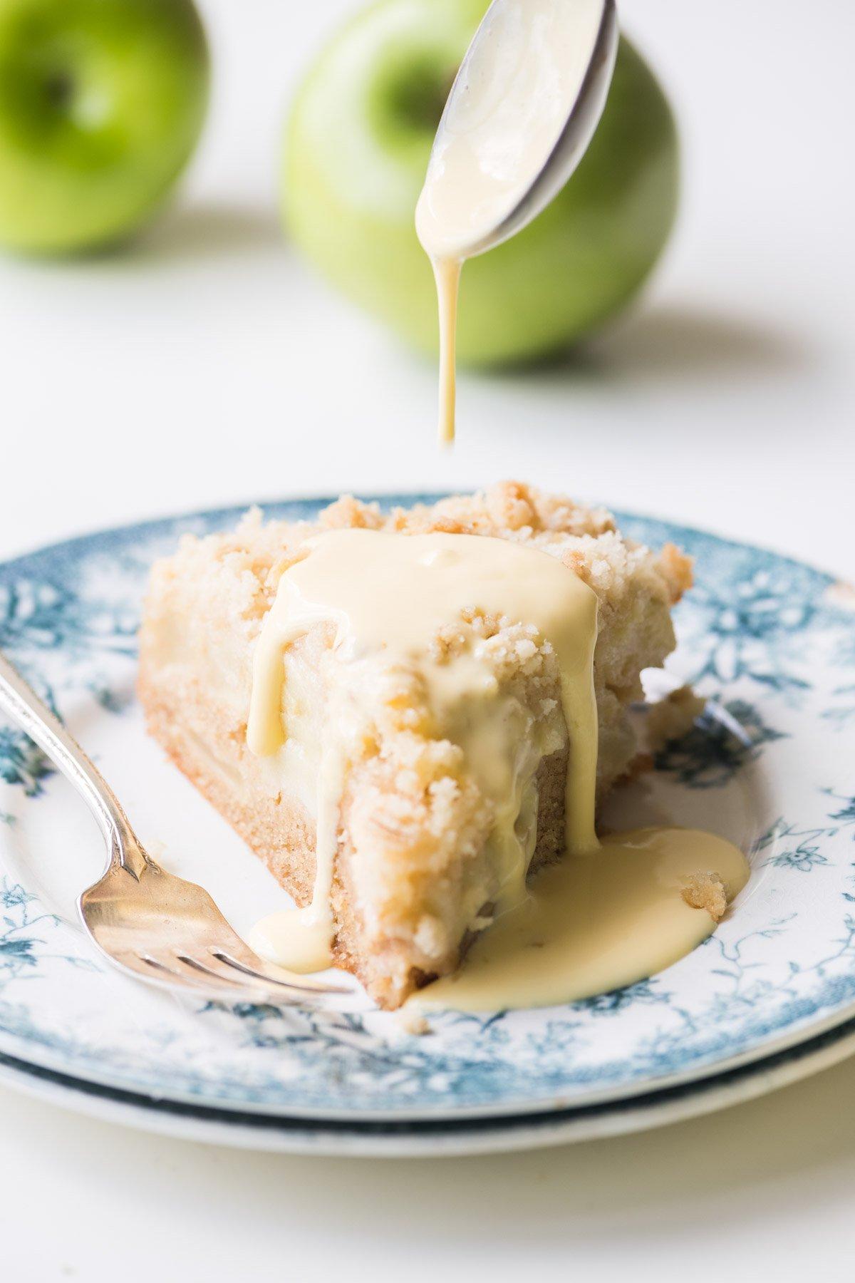 a slice of Irish Apple Cake with custard sauce