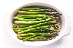 fresh asparagus in a gratin dish