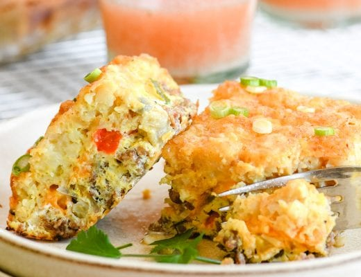 Breakfast casserole with Tater Tot crust, on a plate with fork and juice