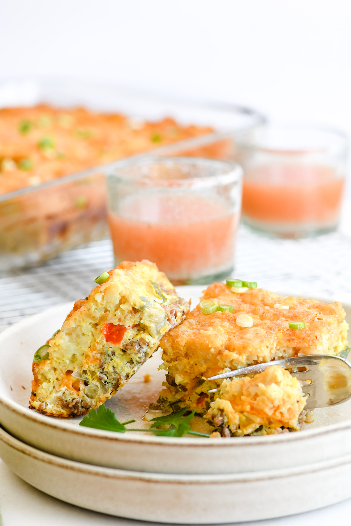 breakfast casserole on a plate with fork.