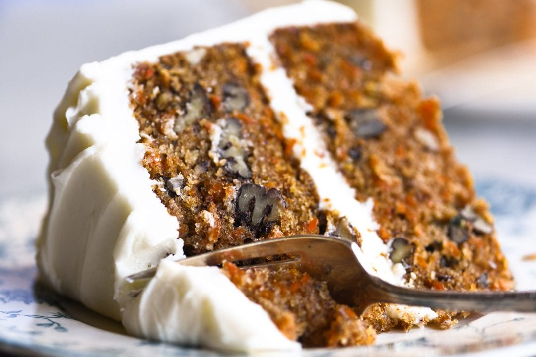 a slice of classic carrot cake with cream cheese frosting