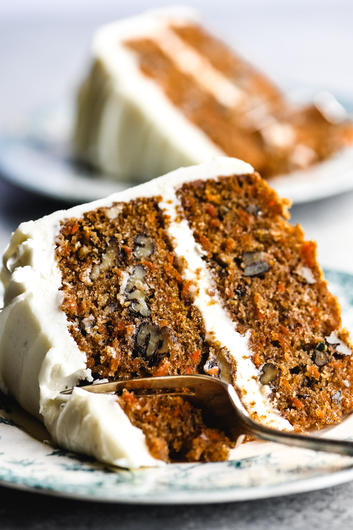 a slice of carrot cake, with cream cheese frosting