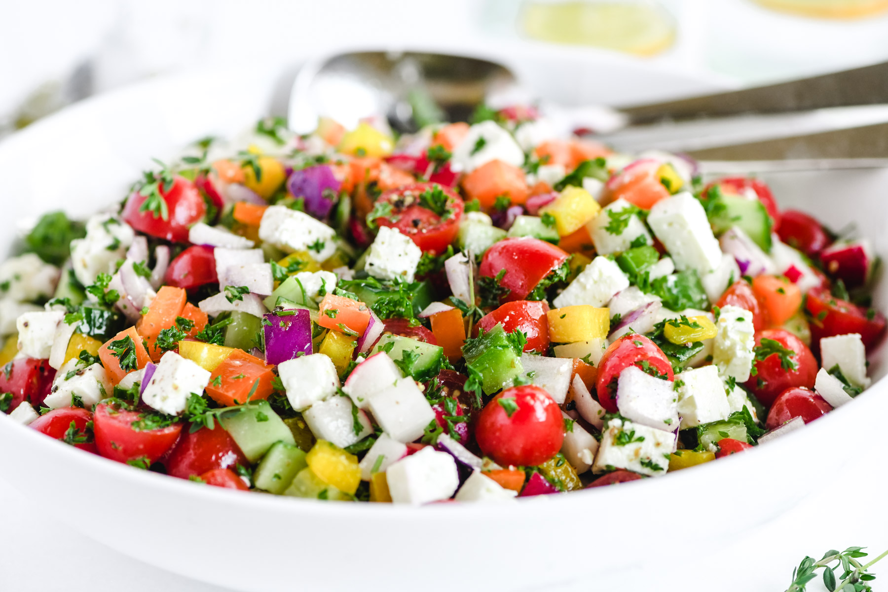 Israeli salad in a white bowl