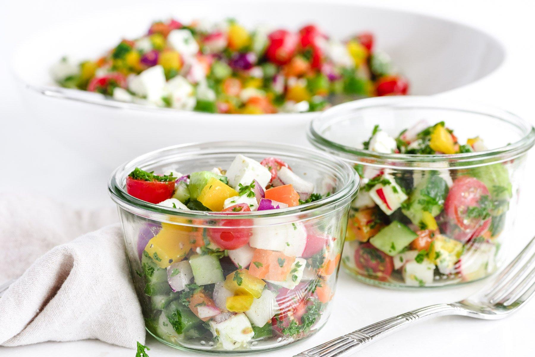 chopped Israeli salad in small jars