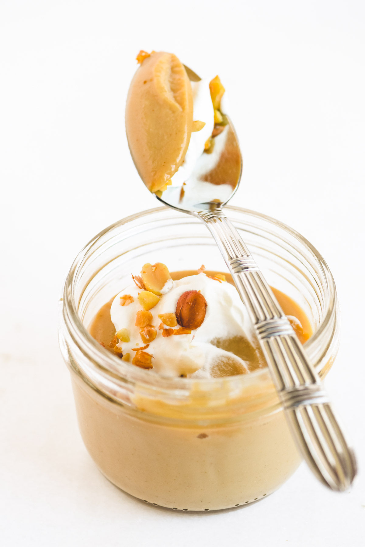 small jar of peanut butter pudding with spoon