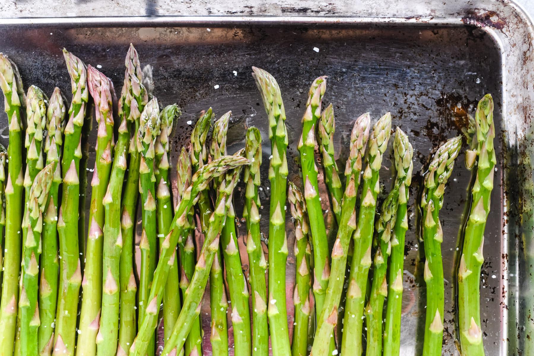 roasting asparagus on a baking sheet