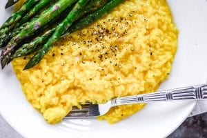 Golden saffron risotto with asparagus on the side