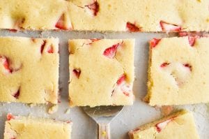 strawberry sheet pan pancakes, sliced into squares