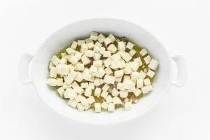 cubes of feta cheese in a baking dish
