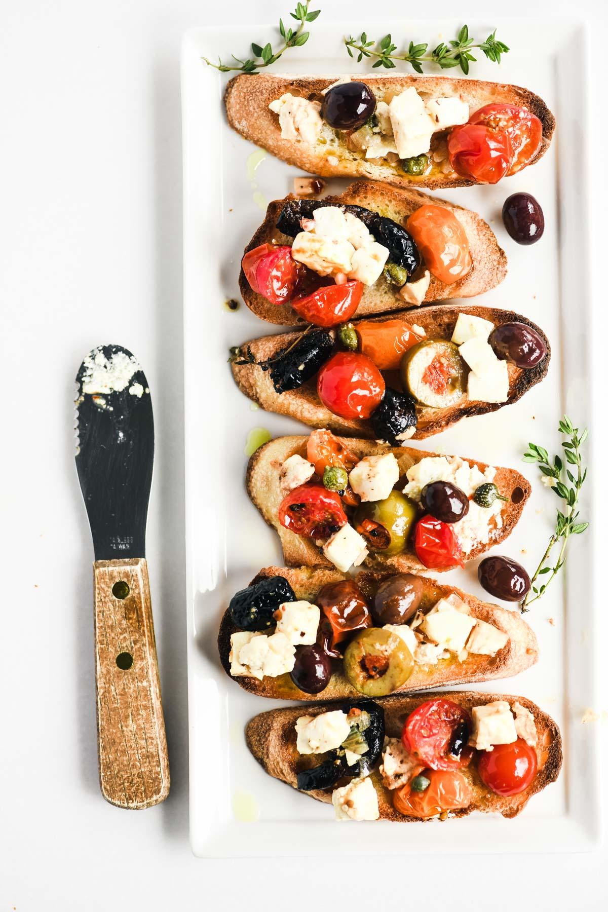 baked feta bruschetta on a platter