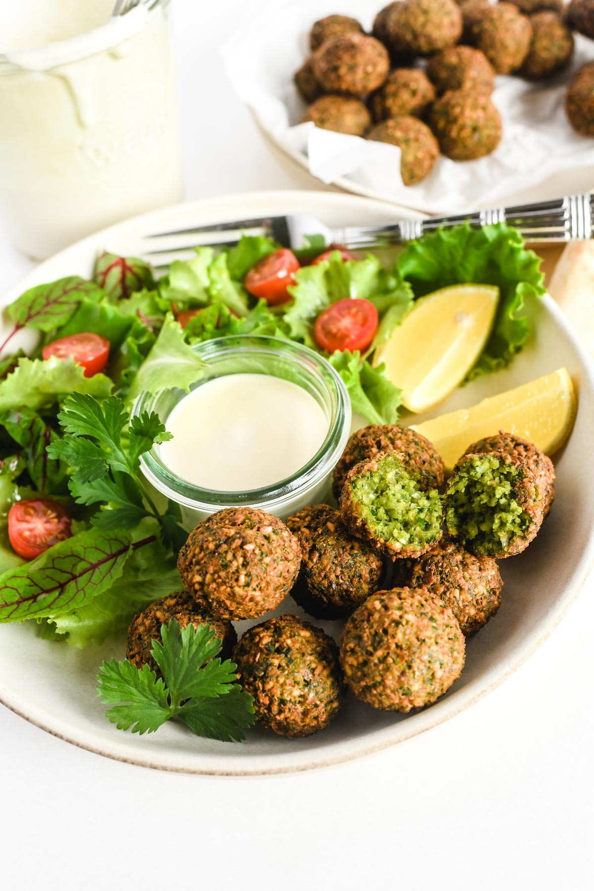 homemade falafel with salad and lemon