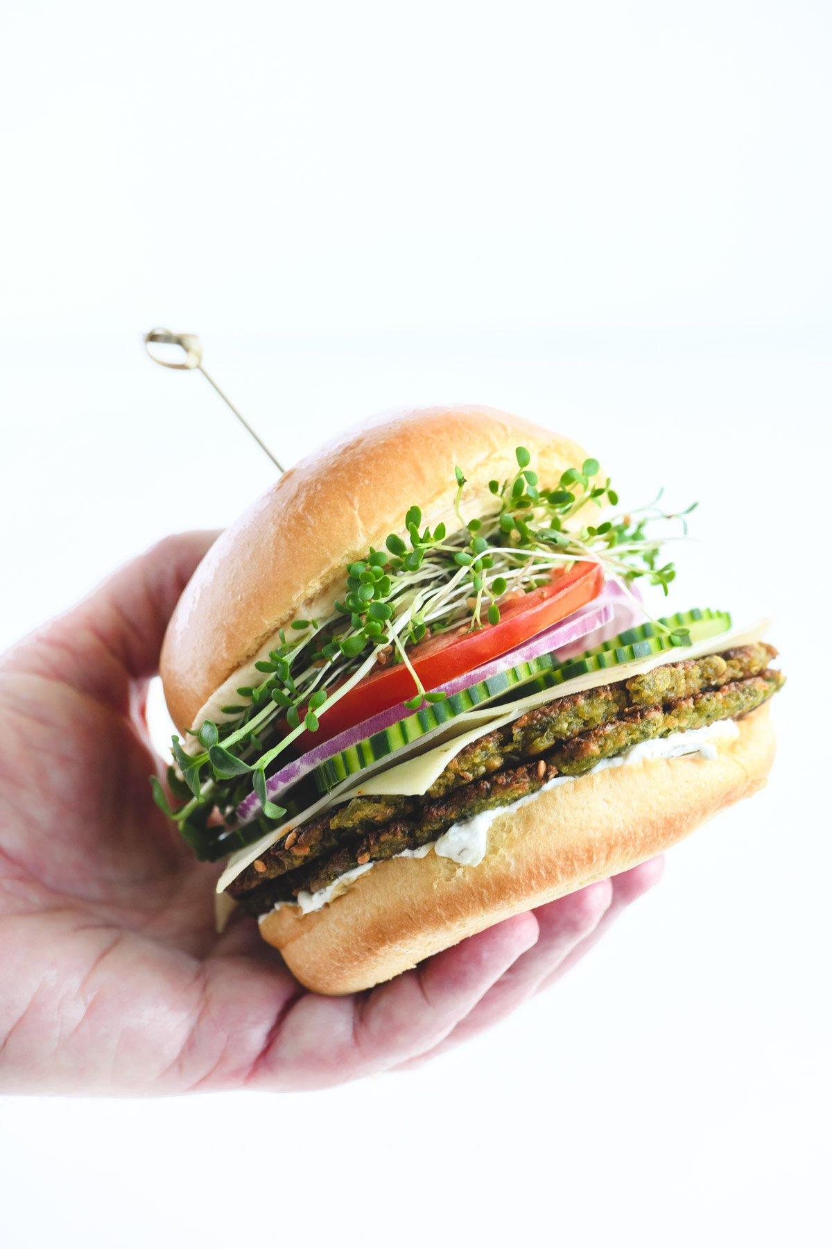 holding a falafel burger