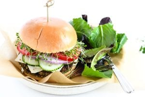 falafel burger on a plate with salad