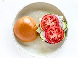 tomato slices on a falafel burger