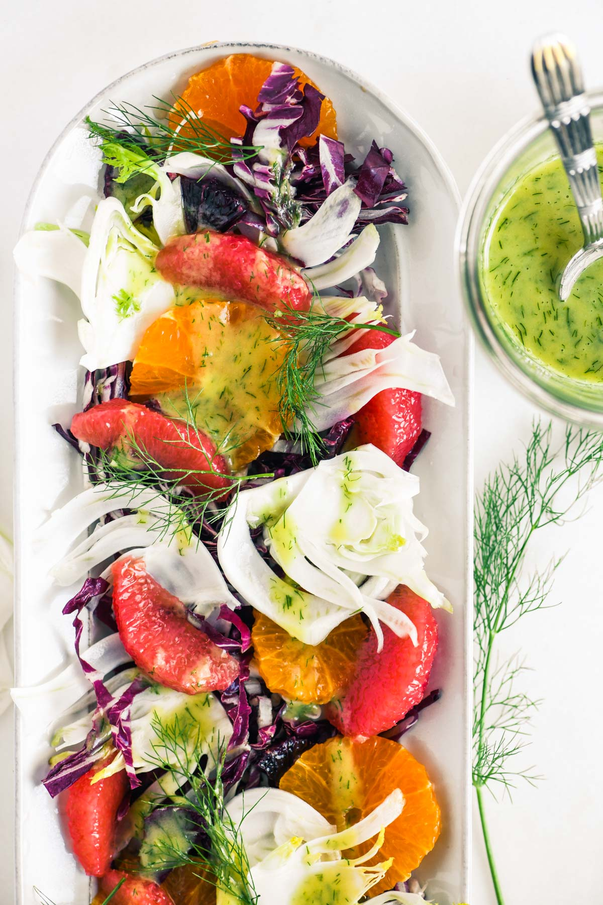 a fennel, radicchio and citrus salad on an oval plate