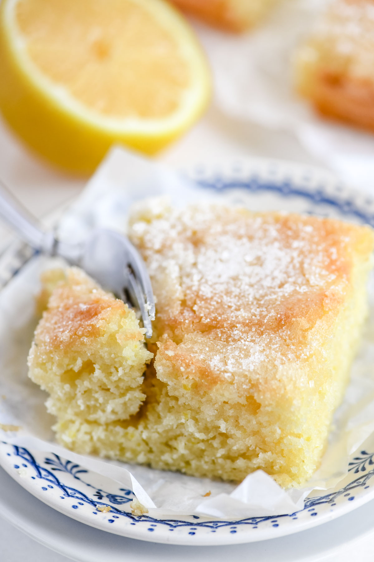 a slice of lemon crunch cake on a plate with fork