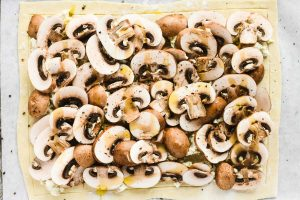 mushrooms and Boursin cheese on sheet of puff pastry