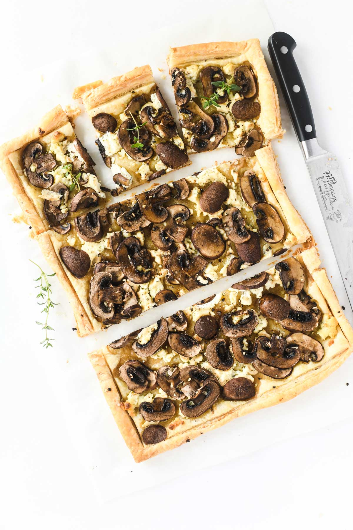 mushroom and Boursin puff pastry tart with knife