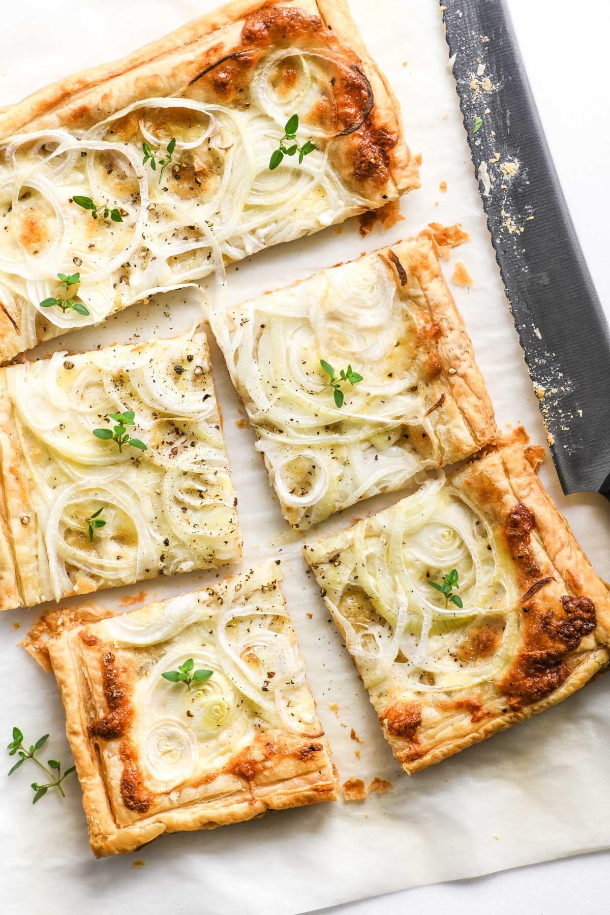 sweet onion puff pastry tart, sliced