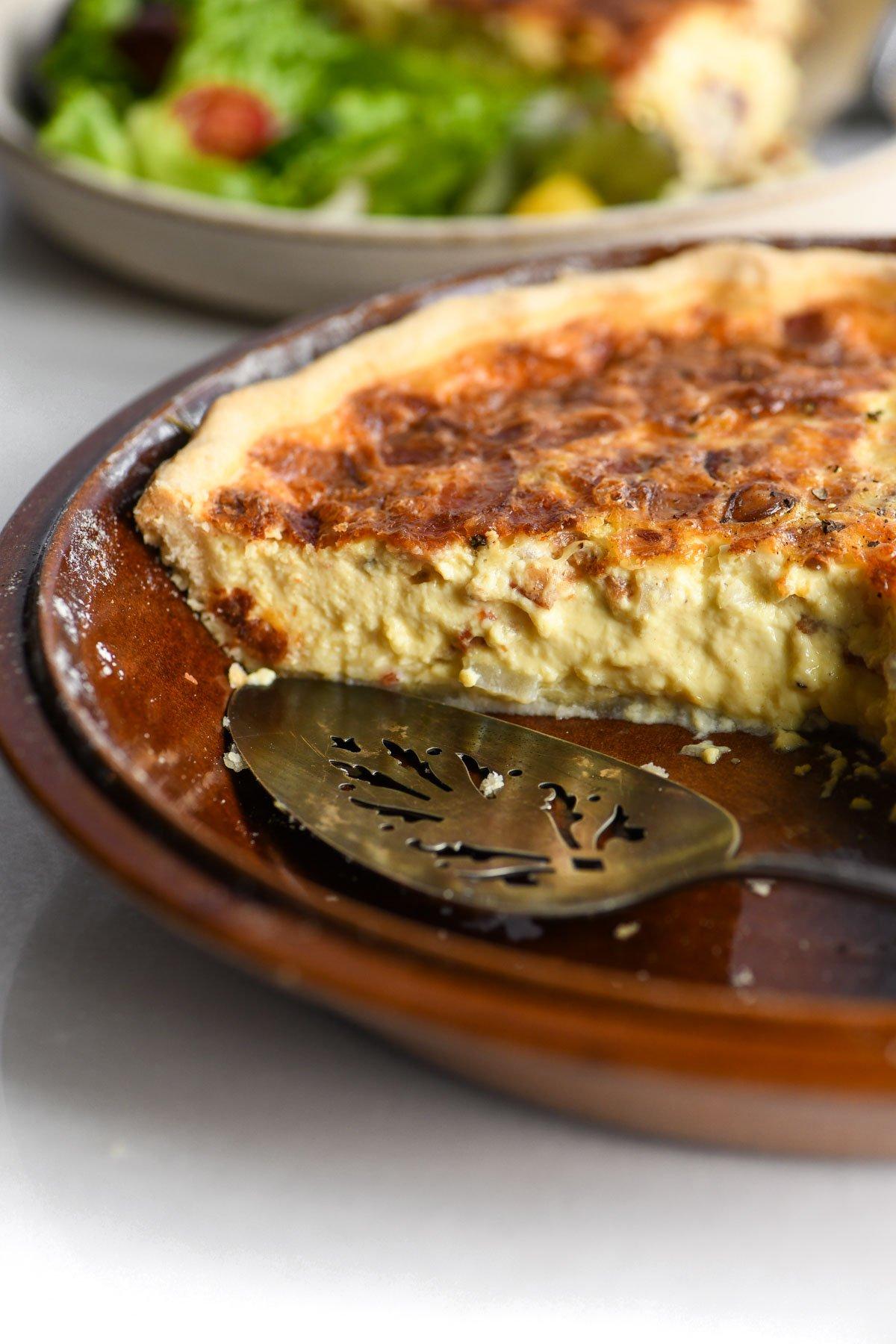 quiche Lorraine in an earthenware pie dish