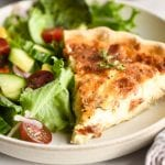 Quiche Lorraine on a plate with salad