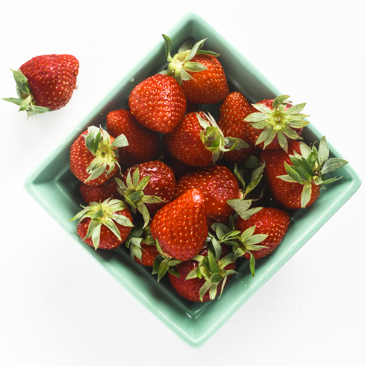 fresh strawberries in a pint container